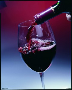 Red Wine Poured Into Glass